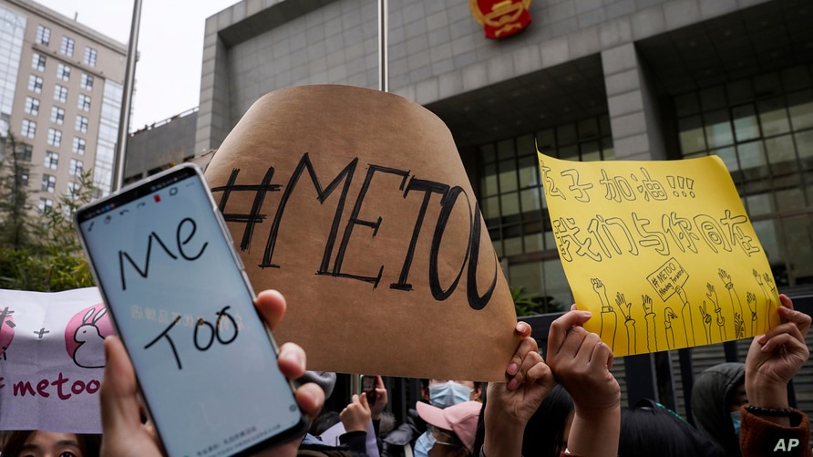 Supporters hold banners as they wait for of Zhou Xiaoxuan outside at a courthouse where Zhou is appearing in a sexual…