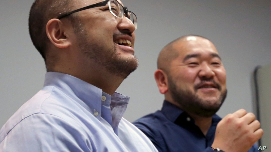 In this Jan. 28, 2019, photo, Kenji Aiba, left, and his partner Ken Kozumi laugh during an interview with The Associated Press…