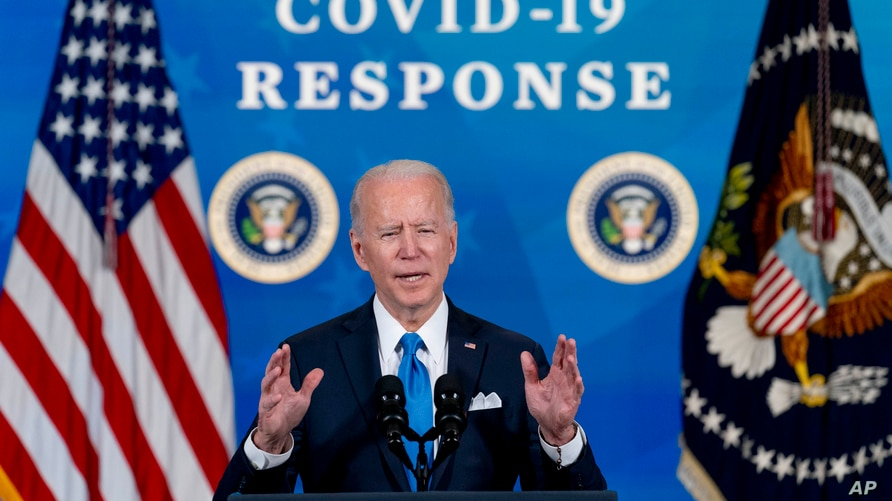 In the March 10, 2020, photo, President Joe Biden speaks in the South Court Auditorium in the Eisenhower Executive Office…