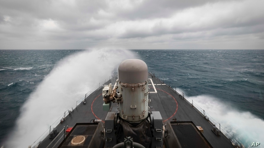 In this photo provided by the U.S. Navy, the guided-missile destroyer USS John S. McCain conducts routine underway operations…