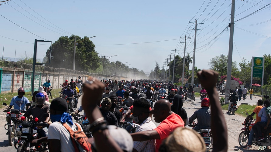 Demonstrators and disgruntled police officers protest in Port-au-Prince, Haiti, Wednesday, March 17, 2021. The protests started…