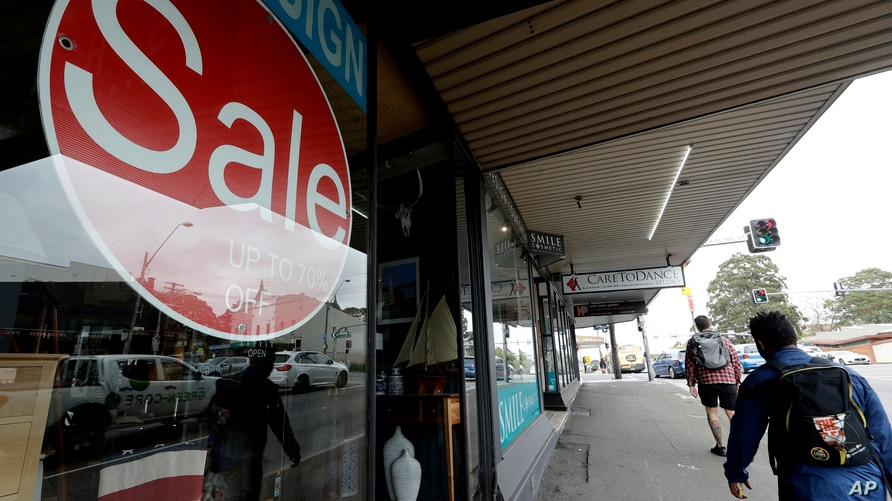 A sign advertising a 70 percent off sale is displayed in a store in Sydney, Tuesday, Oct. 6, 2020. The Australian government…