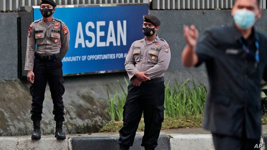 Police officers stand guard outside the Association of Southeast Asian Nations (ASEAN) Secretariat ahead of a leaders' meeting…
