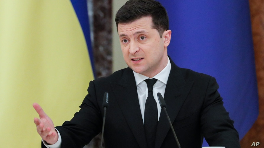 Ukrainian President Volodymyr Zelenskiy talks during a joint media conference with European Council President Charles Michel in…