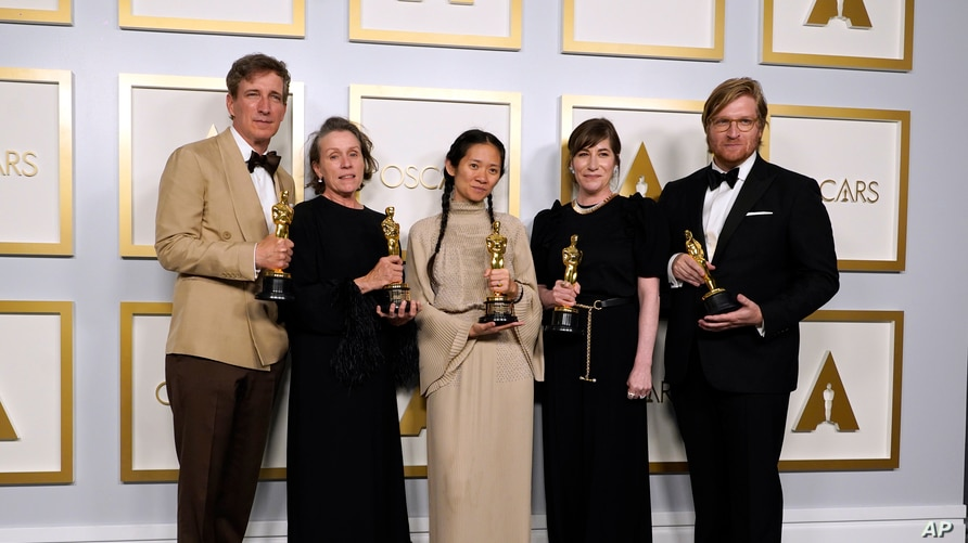 Producers Peter Spears, from left, Frances McDormand, Chloe Zhao, Mollye Asher and Dan Janvey, winners of the award for best…