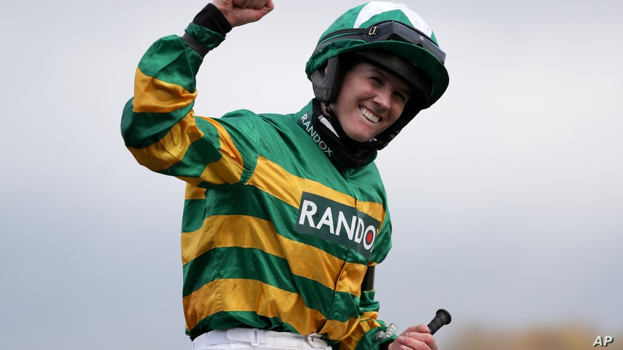 Rachael Blackmore ridding Minella Times celebrates after winning the Randox Grand National Handicap Chase on the third day of…