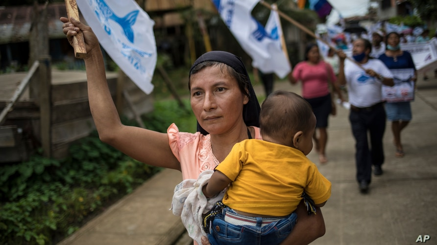 A supporter of the Agricultural People's Front of Peru, known by its acronym Frepap, waves a party banner during a campaign…