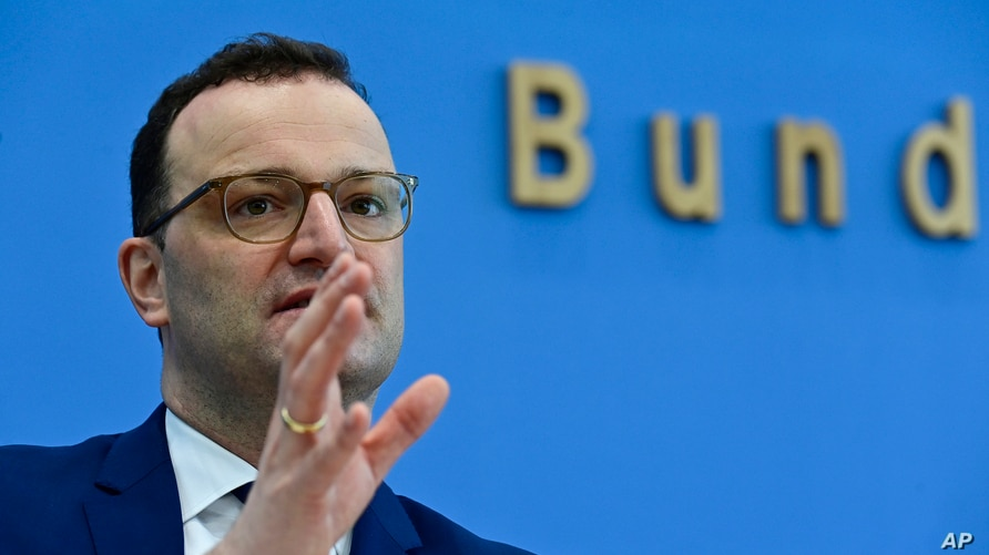 German Health Minister Jens Spahn gestures as he addresses a press conference to inform on the current situation of the…