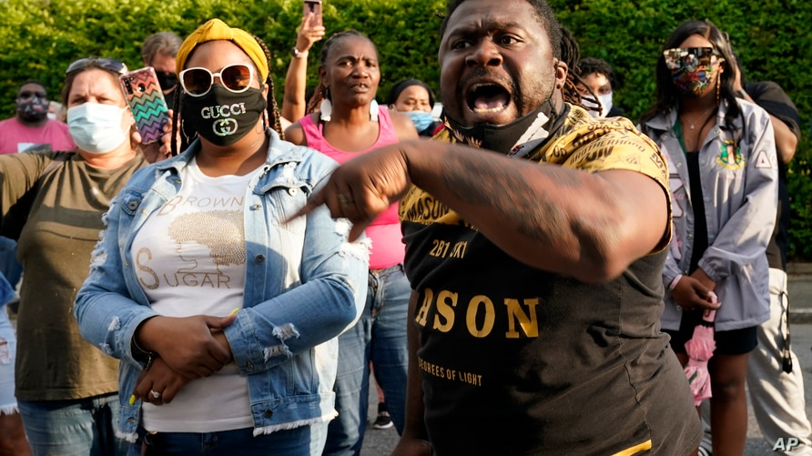 People gather outside the municipal building after at least one Pasquotank County Sheriff's deputy shot and killed a Black man…