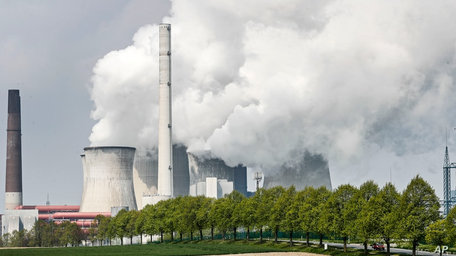 A coal-fired RWE power plant steams on a sunny day in Neurath, Germany, Thursday, April 29, 2021. Germany's top court ruled…