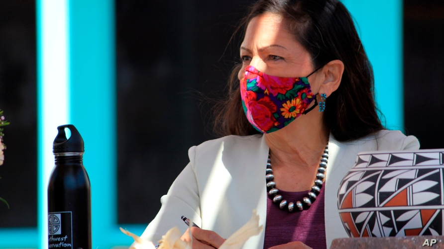 FILE - In this April 6, 2021, file photo, U.S. Interior Secretary Deb Haaland listens to tribal leaders and jots down notes…