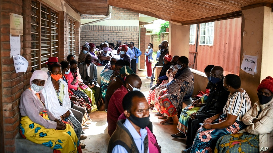 People wait to receive the AstraZeneca COVID-19 vaccine at Ndirande Health Centre in Blantyre Malawi, Monday, March 29, 2021…