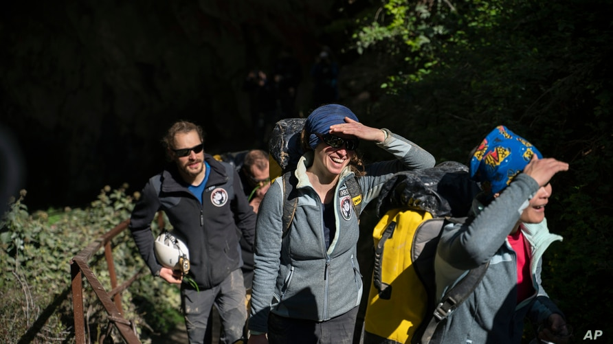 """Members of the French team that participated in the """"Deep Time"""" study, emerge from the Lombrives Cave after 40 days underground…"""