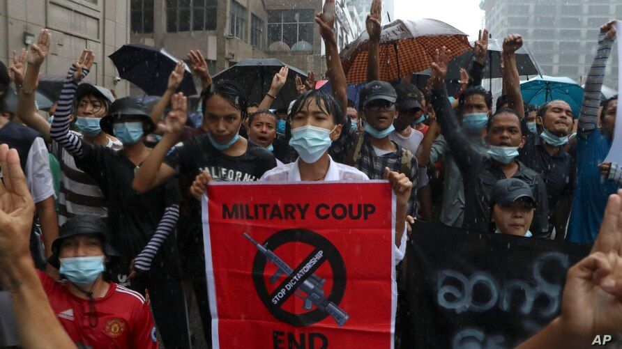 Anti-coup protesters flash the three-finger salute and chant slogan during the demonstration against the military coup in the…