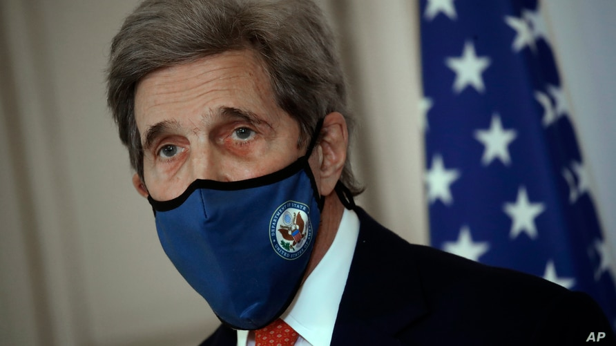 FILE - U.S. special envoy for climate John Kerry attends a news conference Thursday, March 11, 2021 in Paris. Kerry is heading…
