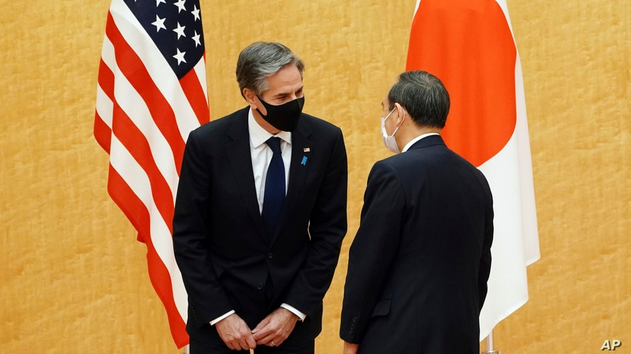 Japanese Prime Minister Yoshihide Suga, right, meets with U.S. Secretary of State Antony Blinken, left, during a courtesy call…