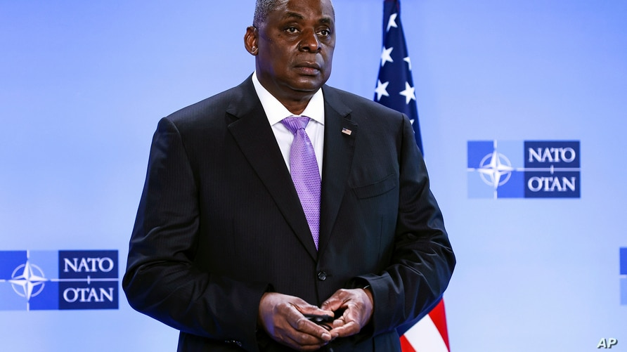 FILE - In this April 14, 2021, file photo, Secretary of Defense Lloyd Austin poses for photographers as he arrives at NATO…