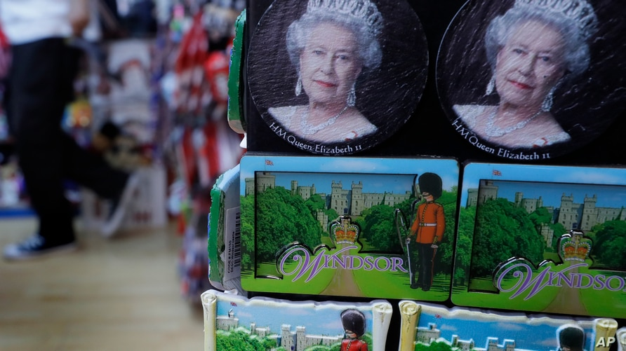 A souvenir shop selling memorabilia with pictures of Queen Elizbeth II, in Windsor, England Wednesday, April 21, 2021. Britain…