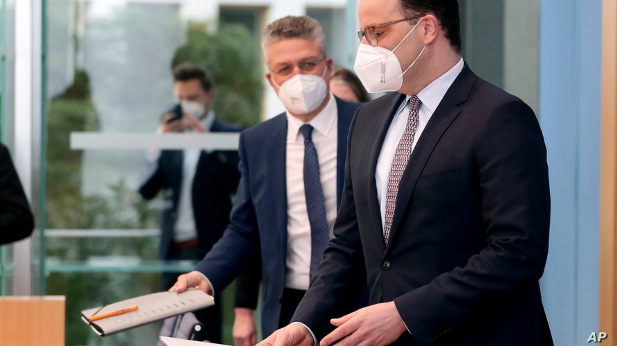 German Health Minister Jens Spahn, right, and Lothar H. Wieler, left, president of the Robert-Koch-Institute, arrive for a…