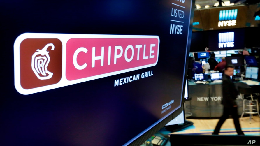 FILE - The logo for Chipotle appears above a trading post on the floor of the New York Stock Exchange. Fedir Hladyr, a 34-year-old Ukrainian, a member of a sophisticated international hacking group that authorities say targeted businesses in 47 states to steal credit and debit card records,