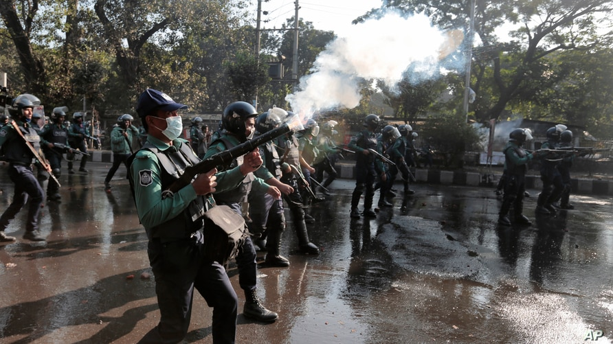 Bangladeshi policemen fire tear gas shells to disperse protestors demanding cancellation of a plan for a massive coal-fired…