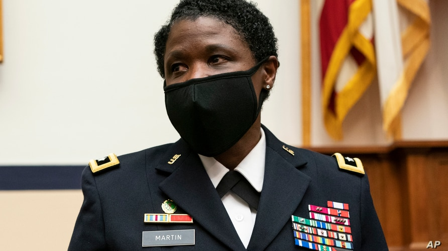 Major Gen. Donna Martin, the Provost Marshal General of the Army, Commanding General U.S. Army Criminal Investigation Command,…