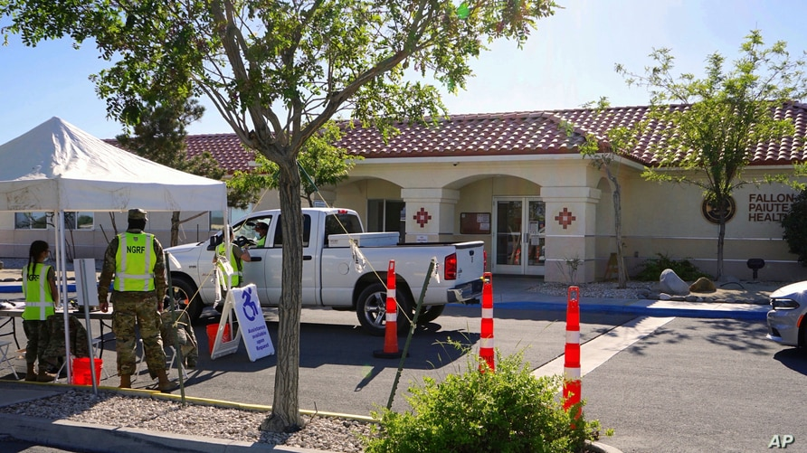 Members of the Nevada National Guard offer coronavirus vaccines at a mobile vaccination clinic held at a tribal health center…
