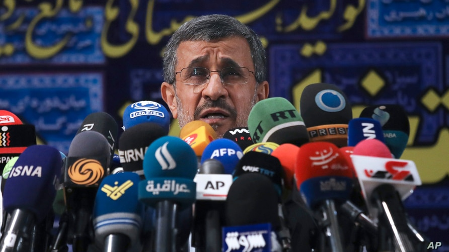 Former President Mahmoud Ahmadinejad speaks with the media after registering his name as a candidate for the June 18…