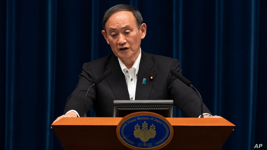 Japanese Prime Minister Yoshihide Suga responds to a reporter's question after he spoke at a news conference in Tokyo on Friday…