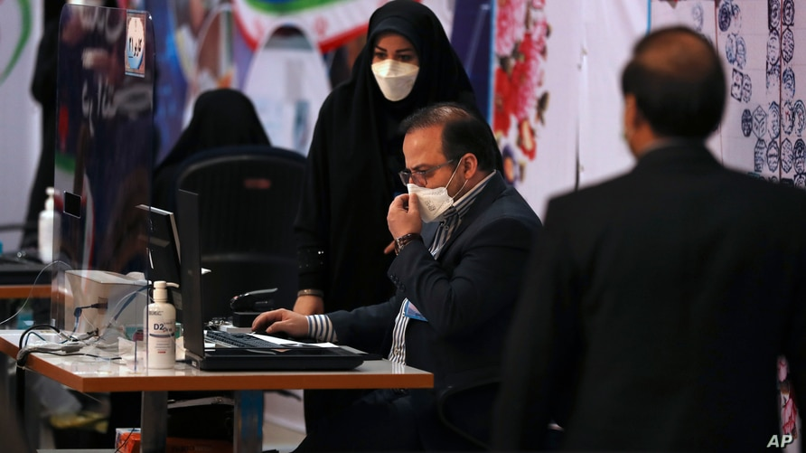 Elections headquarters staff work to register candidates for the June 18 presidential elections at the Interior Ministry in…