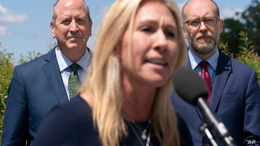 Rep. Marjorie Taylor Greene, R-Ga., center, speaks during a news conference, Wednesday, May 12, 2021, with Rep. Dan Bishop, R-N…
