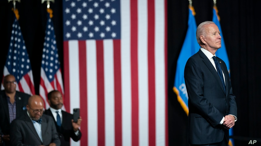 President Joe Biden listened as he is introduced to speak to commemorate the 100th anniversary of the Tulsa race massacre, at…