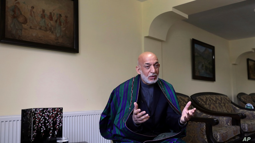 Former Afghan President Hamid Karzai speaks during an interview with the Associated Press at his house, in Kabul, Afghanistan,…