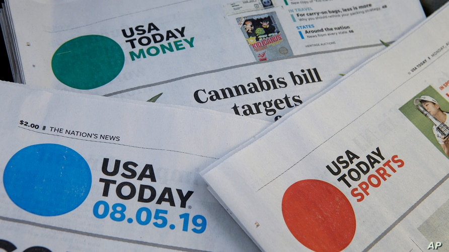 FILE - In this Aug. 5, 2019, file photo, sections of a USA Today newspapers in Norwood, Mass. The FBI issued a subpoena…