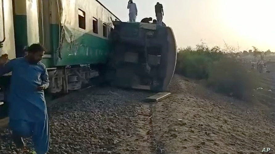 This image from a video, shows the site of a train collision in Ghotki, Pakistan Monday, June 7, 2021. Two express trains…
