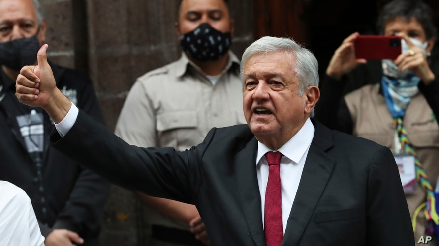 Mexico's President Andres Manuel Lopez Obrador thumbs up after voting in congressional, state and local elections in Mexico…