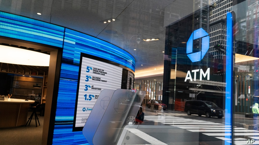A Chase ATM is open, Wednesday, Jan. 13, 2021 in New York.  JPMorgan Chase & Co., the nation's largest bank by assets, said its…