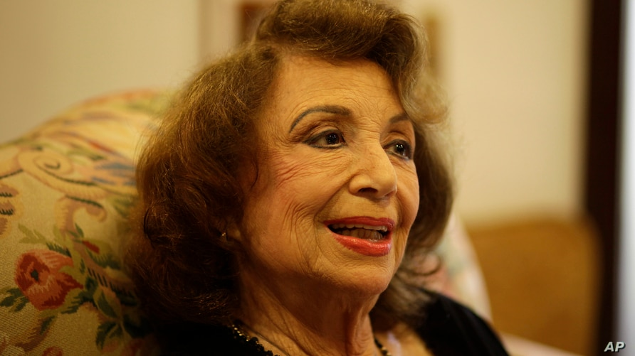 FILE - In this Oct. 24, 2011 file photo, writer Delia Fiallo speaks during an interview in her home in Coral Gables, Fla.