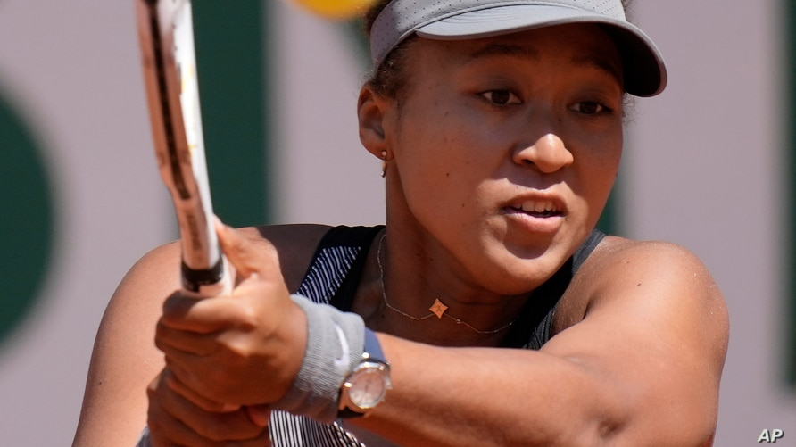 Japan's Naomi Osaka returns the ball to Romania's Patricia Maria Tig during their first round match of the French open tennis…