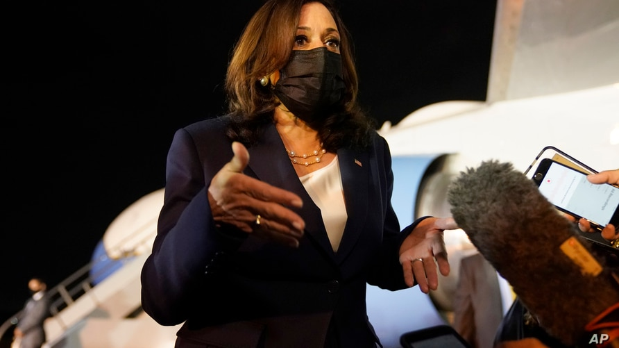 Vice President Kamala Harris talks to the press gathered under the wing of Air Force Two as she prepares to depart for Mexico,…