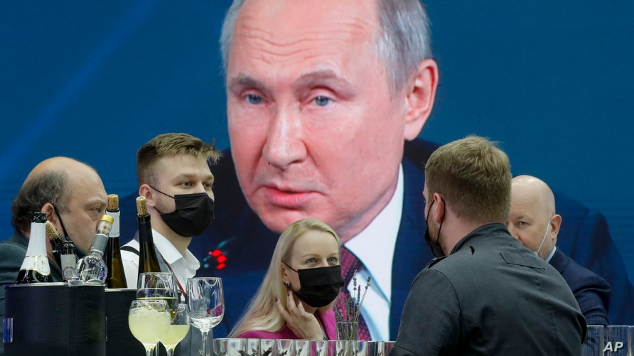 Journalists gather in the press center as they listen to Russian President Vladimir Putin speaking, at the St. Petersburg…
