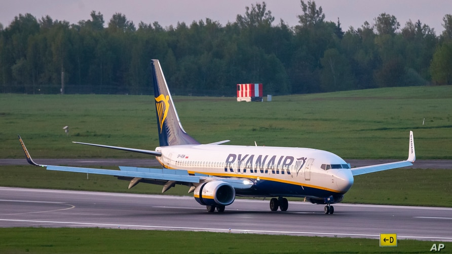 FILE - In this May 23, 2021, file photo, a Ryanair jet that carried opposition figure Raman Pratasevich was diverted to Minsk,…