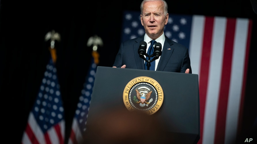 FILE - In this June 1, 2021, file photo, President Joe Biden speaks at the Greenwood Cultural Center in Tulsa, Okla. The…