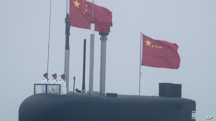 In this April 23, 2019, file photo, a new type 094A Jin-class nuclear submarine Long March 10 of the Chinese People's…