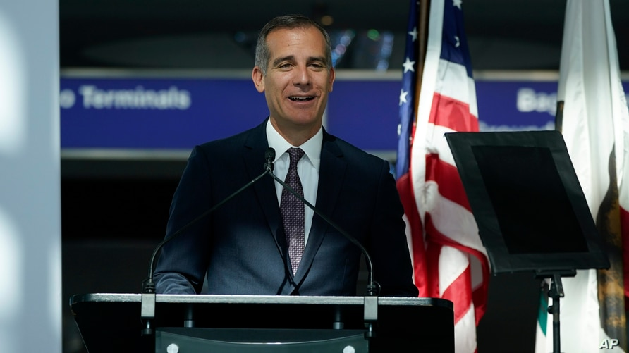 FILE - In this May 24, 2021 file photo Los Angeles Mayor Eric Garcetti speaks a press conference at Los Angeles International…