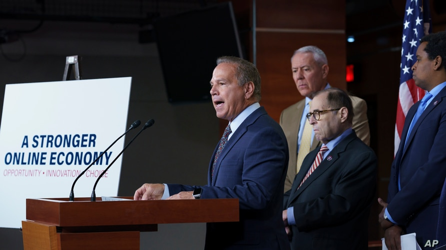 From left, Rep. David Cicilline, D-R.I., chairman of the House Judiciary antitrust subcommittee, Rep. Ken Buck, R-Colo., the…