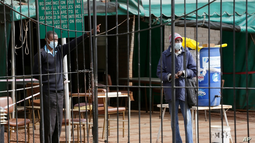 A man is turned away by a guard after he tried to get the Sinopharm coronavirus vaccine at a health facility in Harare,…