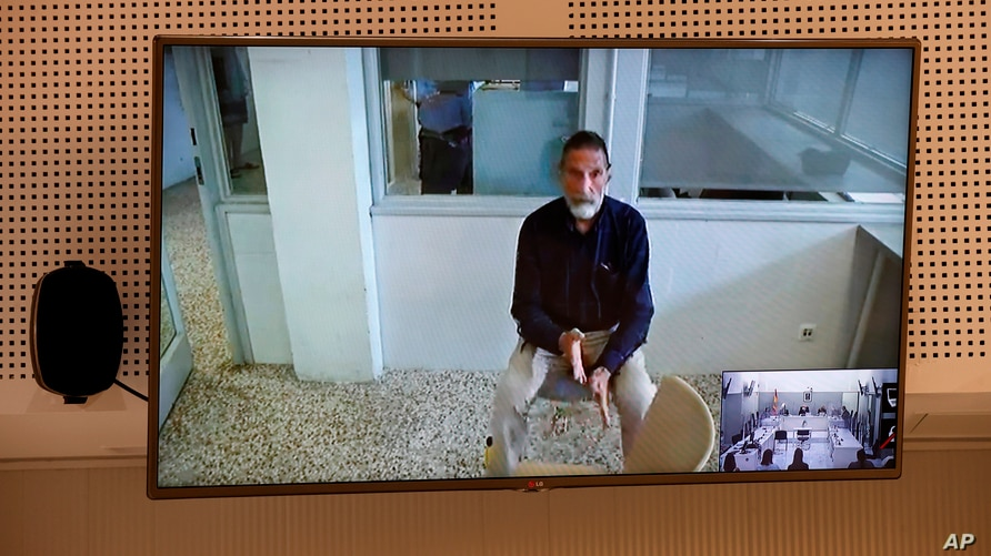 John McAfee, creator of McAfee antivirus software is seen on a screen while testifying via video during an extradition hearing…