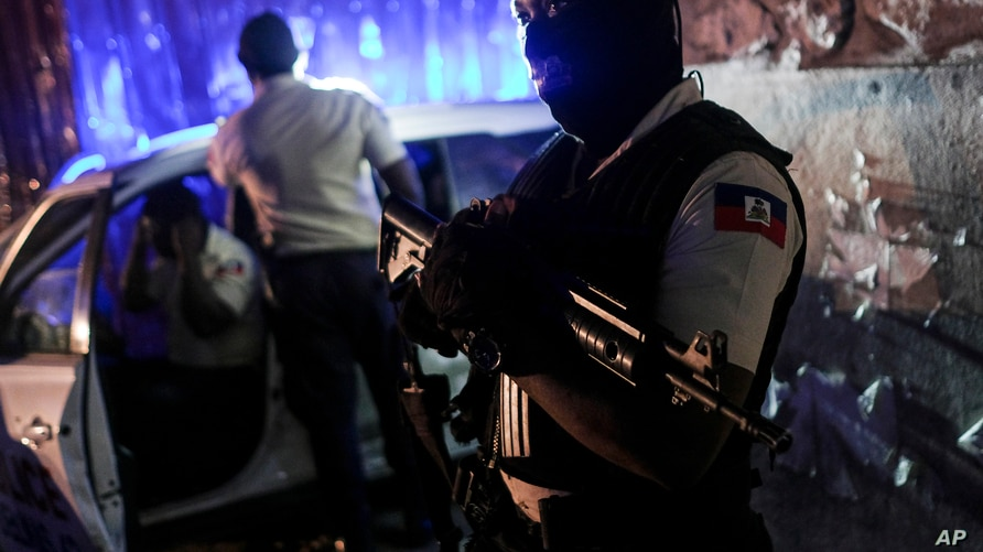 A police officer stands at an intersection in Port-au-Prince, Haiti, late Wednesday, July 14, 2021. Haiti is in the midst of a…