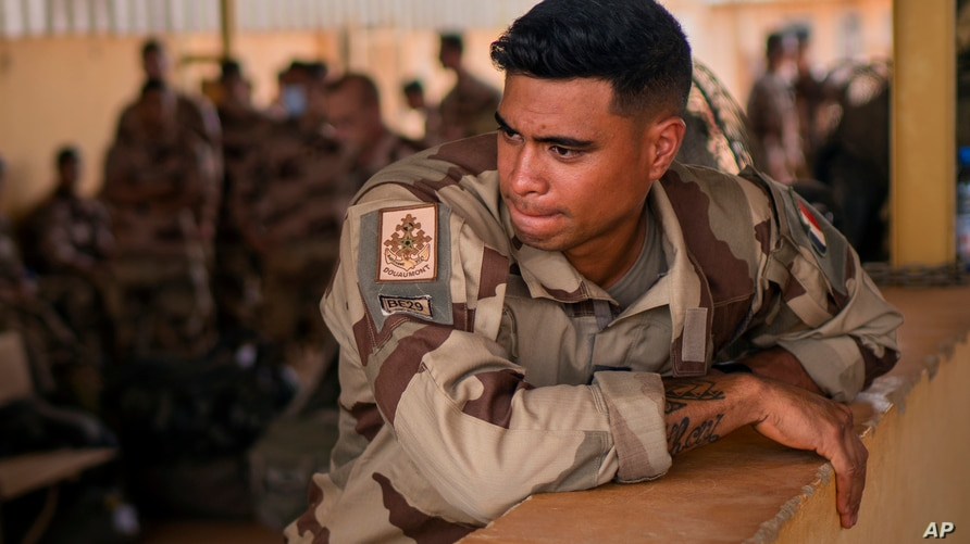 FILE - In this Wednesday June 9, 2021 file photo, French Barkhane force soldiers who wrapped up a four-month tour of duty in…